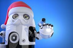 Robot Santa writes something with a pen. Contains clipping path Royalty Free Stock Photo