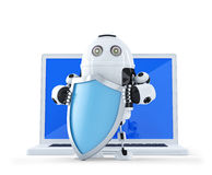 Robot with shielad and laptop. Royalty Free Stock Images