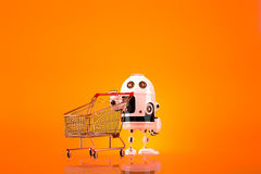 Robot with shopping cart. Contains clipping path.  Royalty Free Stock Photos
