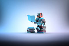 Robot sitting on a bunch of books. Contains clipping path Royalty Free Stock Photos