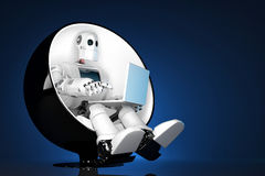 Robot sitting on a chair and holding a laptop. Contains clipping path Stock Photo