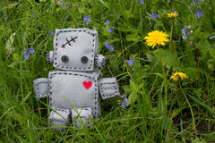 Robot Soft Toy at Green. Robot With Heart. Macro Soft Toy at nature background Royalty Free Stock Photos