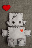 Robot Soft Toy. Robot With Heart. Macro Soft Toy at blurred backgroung Stock Photos