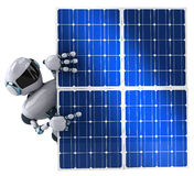 Robot and solar panel Royalty Free Stock Photography