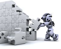 Robot solving jigsaw puzzle Royalty Free Stock Images