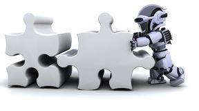 Robot solving jigsaw puzzle Stock Photo