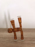 Robot som gör yoga Arkivfoto