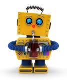 Robot som har en drink Arkivbild