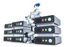 Robot with a stack of servers, hosting concept. Isolated. Contains clipping path. Robot with a stack of servers, hosting concept. Isolated over white. Contains Royalty Free Stock Image