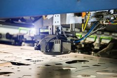 Robot for stamping metal. Products during work. Modern automated factory Royalty Free Stock Image