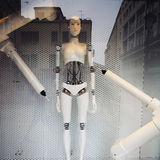 Robot stands in glass window Stock Photography