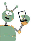 Robot surprised expression looks at bot tablet Stock Photography