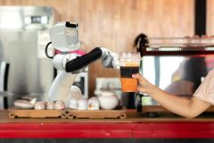 Robot technology hold drinks to people work instead of man royalty free stock images