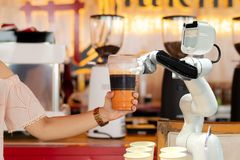 Robot technology hold drinks to people work instead of man royalty free stock photo