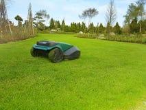 A robot technology lawn mower cutting the grass stock photos