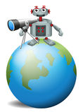 A robot with a telescopeabove the planet earth Stock Photos