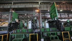 Robot ties up steel bars at the metallurgic factory m/s stock video