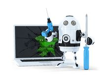 Robot with tools and broken laptop Royalty Free Stock Images