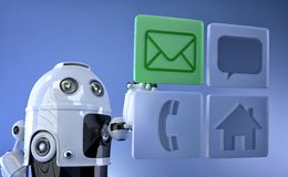 Robot touching virtual mobile icons Royalty Free Stock Images