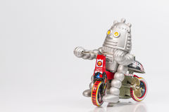 A robot toy is riding bicycle. A vintage robot toy is riding bicycle Royalty Free Stock Photography