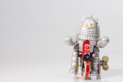 A robot toy is riding bicycle Stock Photo