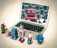 Robot toys getting there instructions Royalty Free Stock Photos