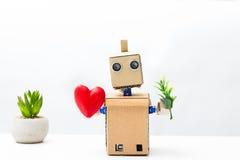 Robot trzyma rośliny w swój ręce w innej ręce i, hea Zdjęcie Royalty Free
