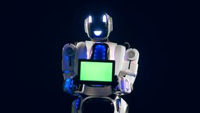 White robot turns to camera, holding a green screen board.