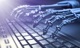Robot typing on a computer keyboard Royalty Free Stock Photo