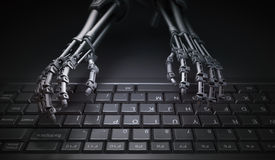 Robot typing on a computer keyboard Royalty Free Stock Photos