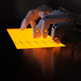 Robot typing on fluorescent keyboard Stock Photo