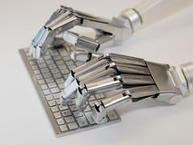 Robot typing on keyboard royalty free stock images