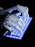 Robot typing on keyboard Stock Images