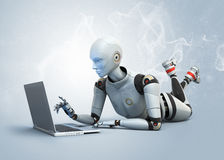 Robot  using laptop Stock Image