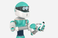 Robot using Smart phone Royalty Free Stock Photography