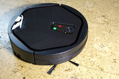 The robot the vacuum cleaner cleans a floor Royalty Free Stock Photography