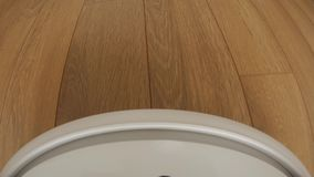 Robot vacuum cleaner on floor, Smart robotic automate wireless cleaning technology machine. Camera mounted directly on the Sweeper stock video footage