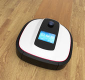 Robot vacuum cleaner moving on flooring Royalty Free Stock Photos