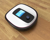 Robot vacuum cleaner moving on flooring Royalty Free Stock Photography