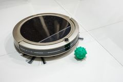 Robot Vacuum cleaner with Pathogenic Bacteria on tile floor in h. Robot Vacuum cleaner with green Pathogenic Bacteria on tile floor in house Royalty Free Stock Photos