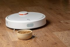 Robot Vacuum Cleaner for pets. bowl food stock photos