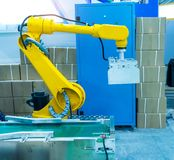 Robot with vacuum suckers with conveyor in manufacture factory stock photography