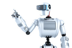 Robot in a virtual reality helmet pointing at invisible object. Contains clipping path Royalty Free Stock Image