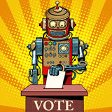 Robot the voter vote on election day. Pop art retro style. Politics and the state. The future of humanity. Science fiction. Artificial intelligence Stock Photography