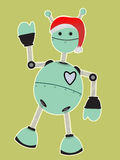 Robot wearing Santa Hat Waving. Happy teal robot waves while wearing a red santa hat Stock Photo