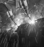 Robot welding black white Stock Images