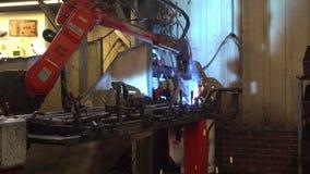 Robot Welding Part in Factory stock video footage