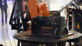 Robot welding is welding assembly automotive part at the exhibition. Media. Exhibition of high-tech machines.  stock video footage