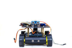 Robot on wheels with different wires on a light background Stock Images