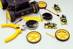 Robot on wheels and tools. Electronics royalty free stock image